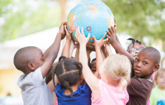 Photo of children holding a globe